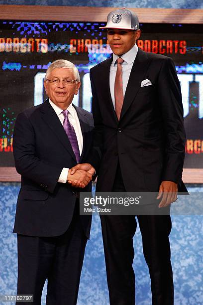 Tobias Harris of the Tennessee Volunteers greets NBA Commissioner David Stern after he was selected overall by the Charlotte Bobcats in the first...