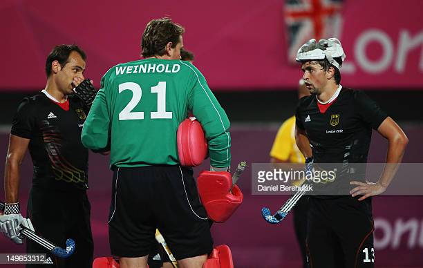 Tobias Hauke talks with goalkeeper Max Winhold of Germany priorto a South Korea penalty during the Men's preliminary Hockey match between South Korea...