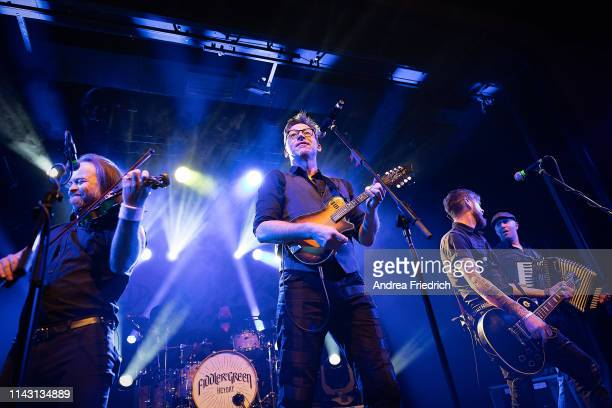Tobias Heindl Frank Jooss Ralf Albers Patrick Prziwara and Stefan Klug of Fiddler's Green perform live on stage during a concert at Columbia Theater...