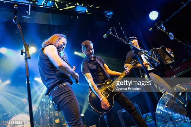 Tobias Heindl Patrick Prziwara and Stefan Klug of Fiddler's Green perform live on stage during a concert at Columbia Theater on May 11 2019 in Berlin...