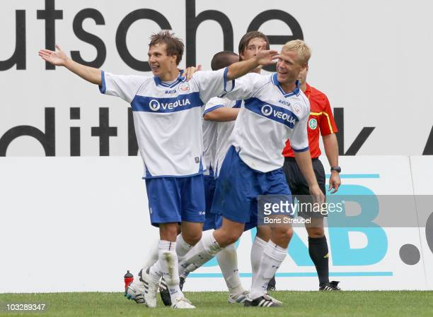 Tobias Jaenicke of Rostock and his team mate Michael Wiemann celebrate the first goal during the Third League match between Hansa Rostock and TuS...