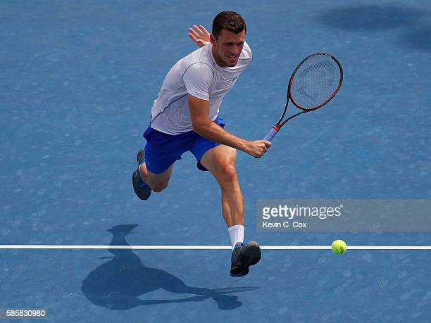Tobias Kamke of Germany attacks the net to return a backhand to Horacio Zeballos of Argentina during the BBT Atlanta Open at Atlantic Station on...