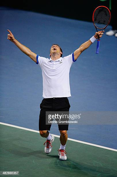 Tobias Kamke of Germany celebrates after winning his match against Julien Benneteau of France during day 1 of the Davis Cup Quarter Final match...