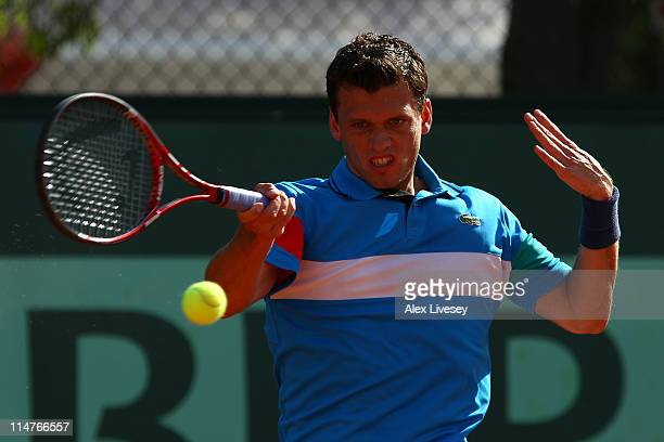Tobias Kamke of Germany hits a forehand during the men's singles round two match between Tobias Kamke of Germany and Viktor Troicki of Serbia on day...