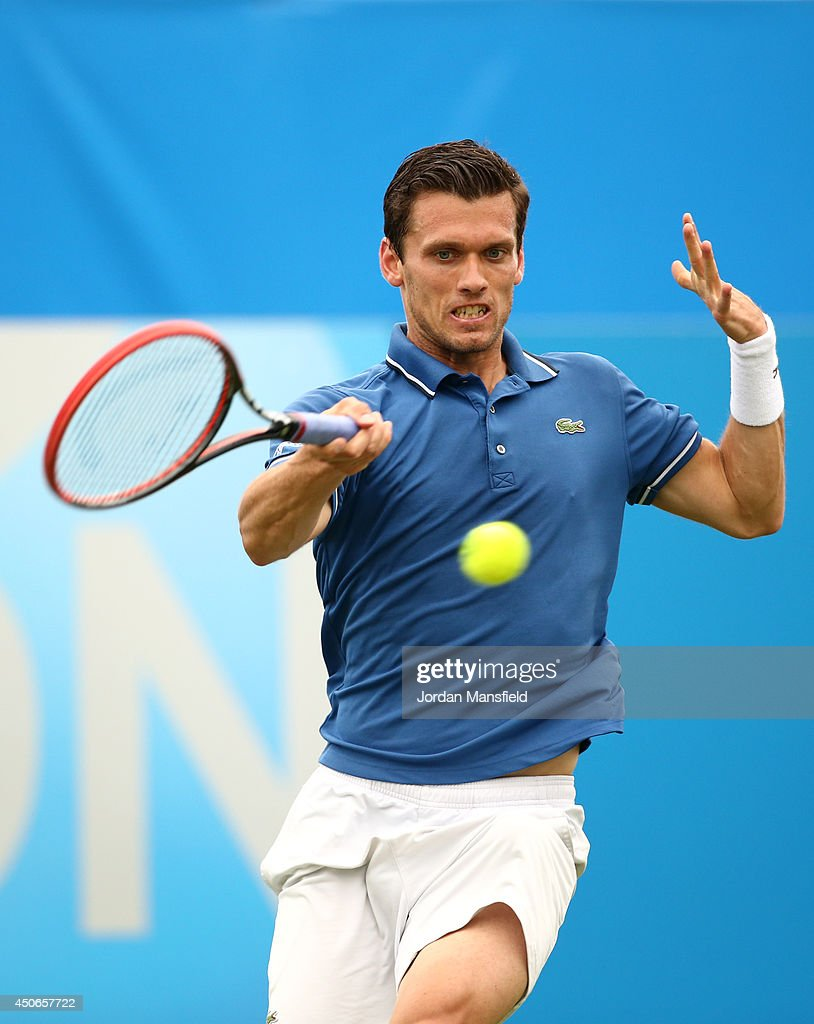 Tobias Kamke of Germany in action against David Goffin of Belgium during their Men's Singles third round qualifying match on day two of the Aegon International at Devonshire Park on June 15, 2014 in Eastbourne, England.