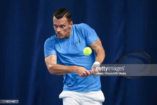 Tobias Kamke of Germany in action against Liam Broady of Great Britain during day two of the Nature Valley Open at Nottingham Tennis Centre on June...