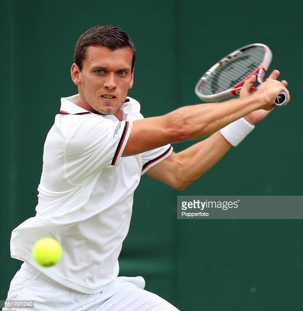 Tobias Kamke of Germany in action during his men's singles first round match against Richard Gasquet of France on Day One of the Wimbledon Lawn...