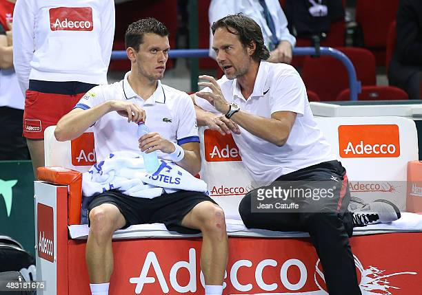Tobias Kamke of Germany listens to german Davis Cup captain Carsten Arriens during the second round Davis Cup match between France and Germany at...
