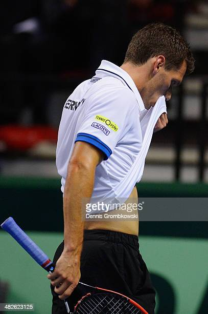Tobias Kamke of Germany looks dejected during his match against Julien Benneteau of France during day 1 of the Davis Cup Quarter Final match between...