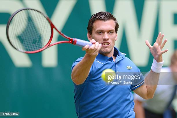 Tobias Kamke of Germany play a forehand in his match against Philipp Kohlschreiber of Germany during day four of the Gerry Weber Open at Gerry Weber...