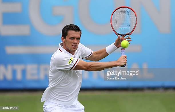 Tobias Kamke of Germany plays a backhand against Daniel Evans of Great Britain during their Men's Singles first round match on day three of the Aegon...
