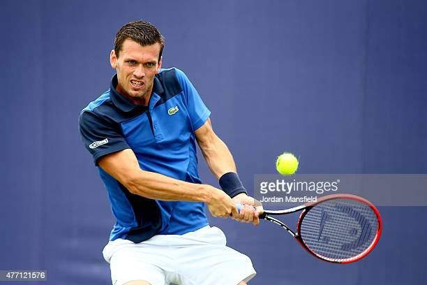 Tobias Kamke of Germany plays a backhand during his Qualification match of the Aegon Championships against Jared Donaldson of the USA at Queens Club...