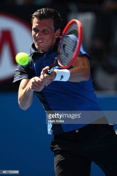 Tobias Kamke of Germany plays a backhand in his first round match against Bernard Tomic of Australia during day one of the 2015 Australian Open at...