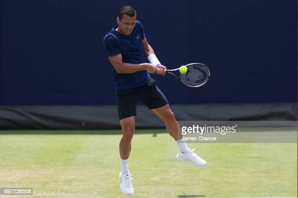 Tobias Kamke of Germany plays a backhand shot during the qualifying match against Julien Benneteau of France ahead of the Aegon Championships at...