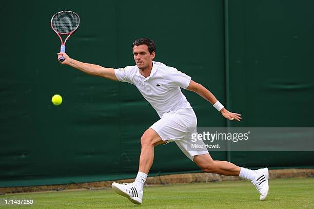 Tobias Kamke of Germany plays a forehand during his Gentlemen's singles first round match against Julien Benneteau of France on day one of the...