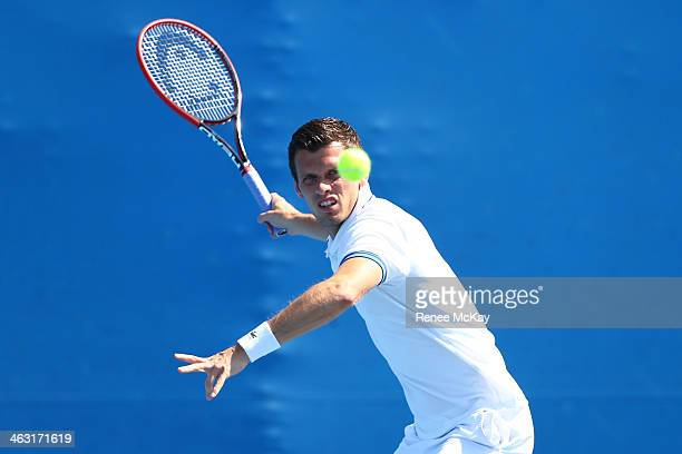 Tobias Kamke of Germany plays a forehand in his second round doubles match with Florian Mayer of Germany against Andreas Seppi of Italy and Potito...