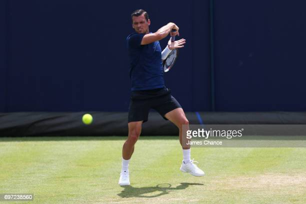 Tobias Kamke of Germany plays a forehand shot during the qualifying match against Julien Benneteau of France ahead of the Aegon Championships at...