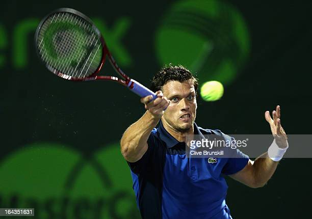 Tobias Kamke of Germany plays a forehand to Juan Martin Del Potro of Argentina during their second round match at the Sony Open at Crandon Park...
