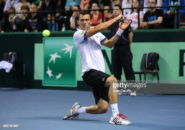 Tobias Kamke of Germany plays against JoWilfried Tsonga of France during the second round Davis Cup match between France and Germany at Palais des...