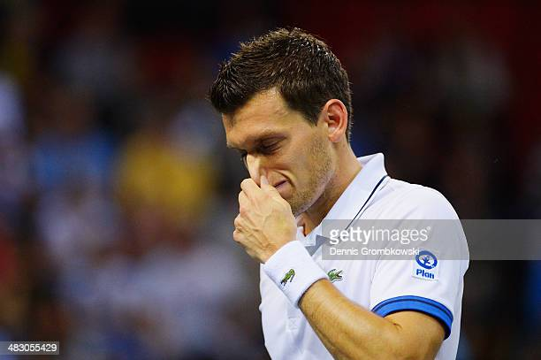Tobias Kamke of Germany reacts during his match against JoWilfried Tsonga of France during day 3 of the Davis Cup Quarter Final match between France...