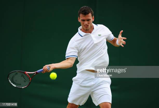 Tobias Kamke of Germany returns a shot during his first round match against Blaz Kavcic of Slovenia on Day One of the Wimbledon Lawn Tennis...