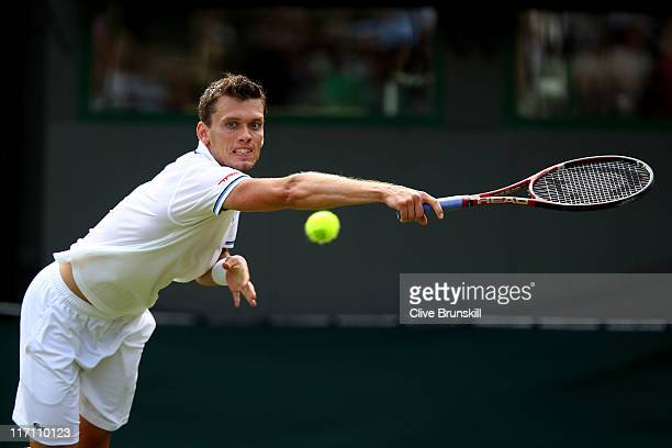 Tobias Kamke of Germany returns a shot during his second round match against Andy Murray of Great Britain on Day Three of the Wimbledon Lawn Tennis...