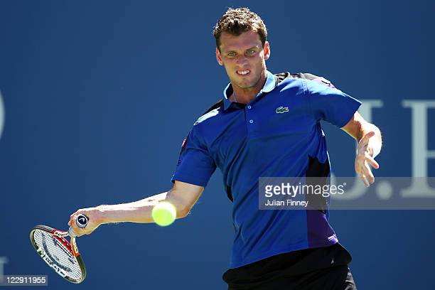Tobias Kamke of Germany returns the ball against Mardy Fish during Day One of the 2011 US Open at the USTA Billie Jean King National Tennis Center on...