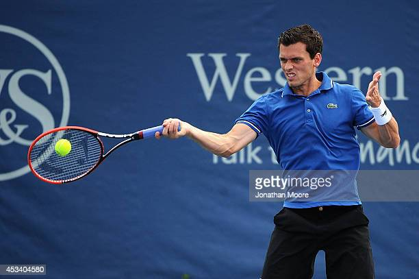 Tobias Kamke of Germany returns to James Ward of England during day 1 of the Western and Southern Open on August 9 2014 in Cincinnati Ohio