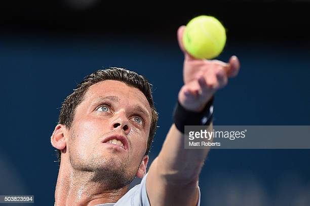 Tobias Kamke of Germany serves in his match against Roger Federer of Switzerland during day five of the 2016 Brisbane International at Pat Rafter...