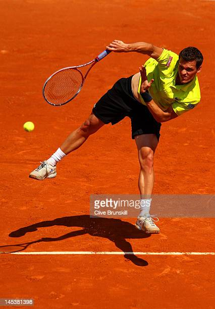 Tobias Kamke of Germany serves in the men's singles first round match between Roger Federer of Switzerland and Tobias Kamke of Germany during day two...