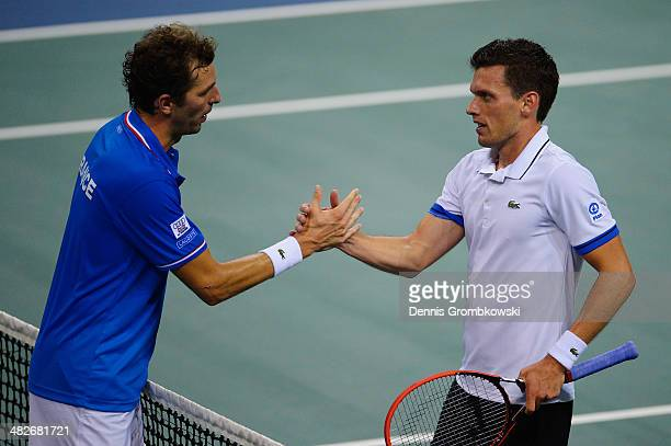 Tobias Kamke of Germany shakes hands with Julien Benneteau of France after winning his match against Julien Benneteau of France during day 1 of the...