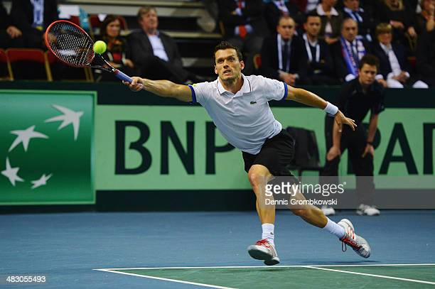 Tobias Kamke of Germany stretches for the ball during his match against JoWilfried Tsonga of France during day 3 of the Davis Cup Quarter Final match...