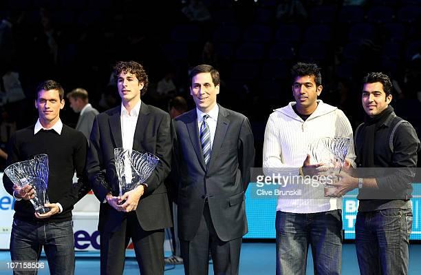 Tobias Kamke of Germany winner ATP Newcomer of the Year 2010 award Robin Haase winner of Comeback Player of the Year award ATP CEO Adam Helfant and...