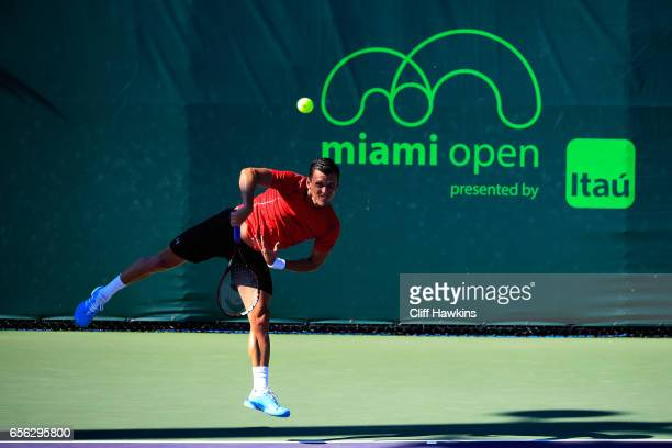 Tobias Kamke of Gremany serves to Aljaz Bedene of Great Britain during their qualifier for the Miami Open at Crandon Park Tennis Center on March 21...