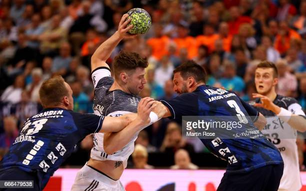 Tobias Karlsson of Flensburg challenges Niclas Ekberg of Kiel for the ball during the Rewe Final Four final match between SG FlensburgHandewitt and...