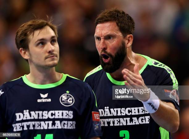 Tobias Karlsson of Flensburg Handewitt argues with team mate Hampus Wanne during the Velux EHF Champions League round of 16 second leg match between...