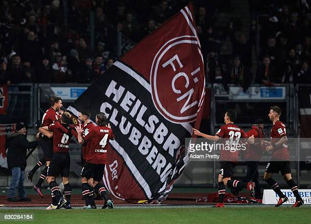 Tobias Kempe of 1 FC Nuernberg is congratulated after scoring a goal during the Second Bundesliga match between 1 FC Nuernberg and 1 FC...
