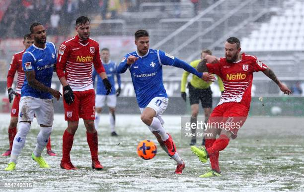 Tobias Kempe of Darmstadt and Marvin Knoll of Regensburg battle for the ball during the Second Bundesliga match between SV Darmstadt 98 and SSV Jahn...