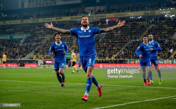 Tobias Kempe of Darmstadt celebrates after his team's second goal during the Second Bundesliga match between SG Dynamo Dresden and SV Darmstadt 98 at...