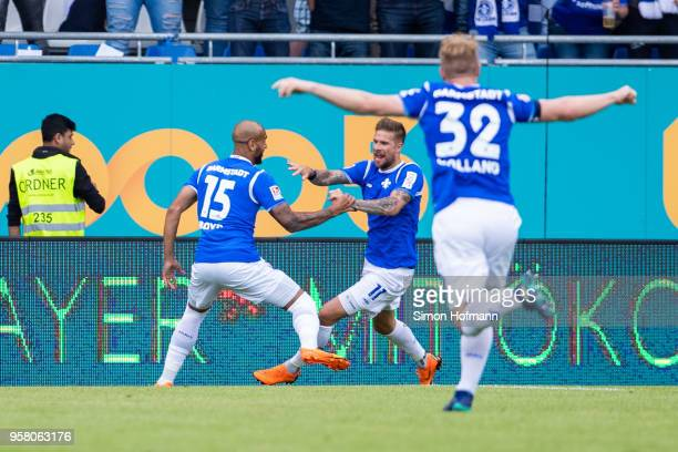Tobias Kempe of Darmstadt celebrates his team's first goal with his team mates Terrence Boyd and Fabian Holland during the Second Bundesliga match...