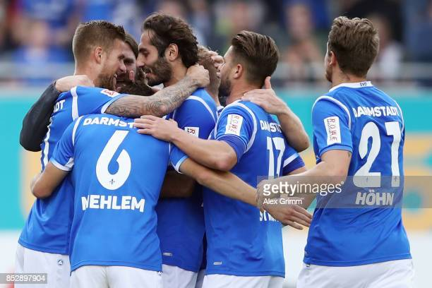 Tobias Kempe of Darmstadt celebrates his team's first goal with team mates and head coach Torsten Frings during the Second Bundesliga match between...