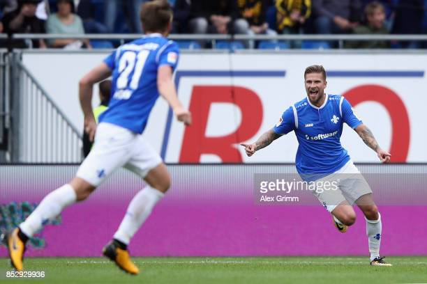 Tobias Kempe of Darmstadt celebrates his team's third goal during the Second Bundesliga match between SV Darmstadt 98 and SG Dynamo Dresden at...