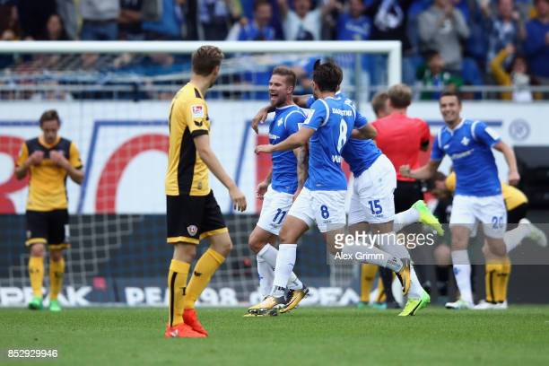 Tobias Kempe of Darmstadt celebrates his team's third goal with team mates during the Second Bundesliga match between SV Darmstadt 98 and SG Dynamo...