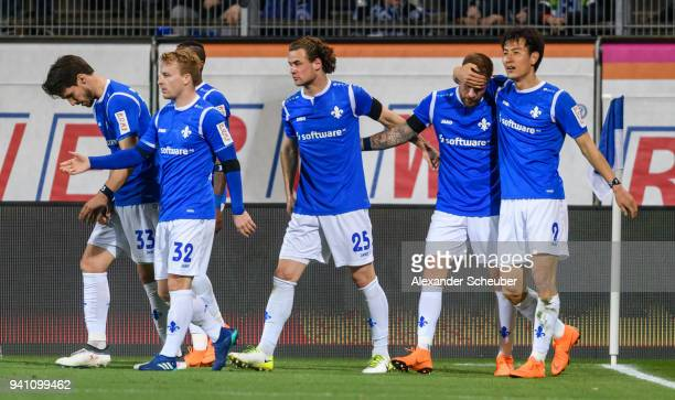 Tobias Kempe of Darmstadt celebrates the first goal for his team with his teammates during the Second Bundesliga match between SV Darmstadt 98 and...