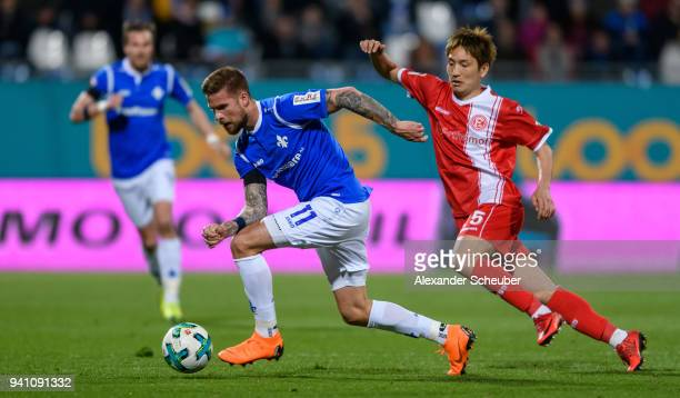 Tobias Kempe of Darmstadt in action against Genki Haraguchi of Duesseldorf during the Second Bundesliga match between SV Darmstadt 98 and Fortuna...
