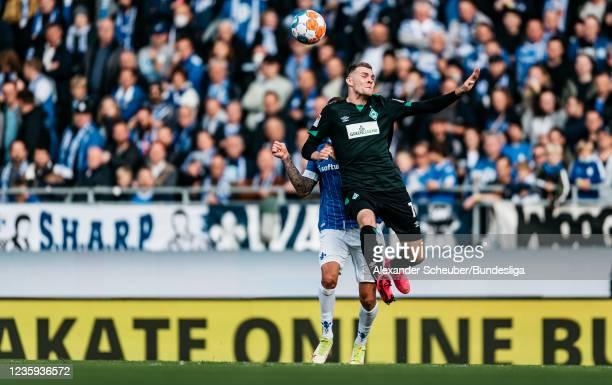 Tobias Kempe of Darmstadt in action against Marvin Ducksch of Bremen during the Second Bundesliga match between SV Darmstadt 98 and SV Werder Bremen...