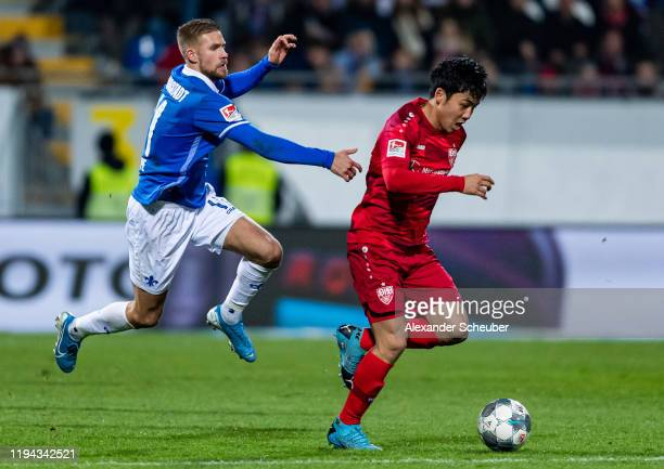 Tobias Kempe of Darmstadt in action against Wataru Endo of Stuttgart during the Second Bundesliga match between SV Darmstadt 98 and VfB Stuttgart at...