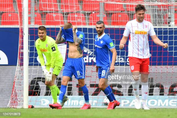 Tobias Kempe of Darmstadt reacts after missing a penalty during the Second Bundesliga match between SSV Jahn Regensburg and SV Darmstadt 98 at...