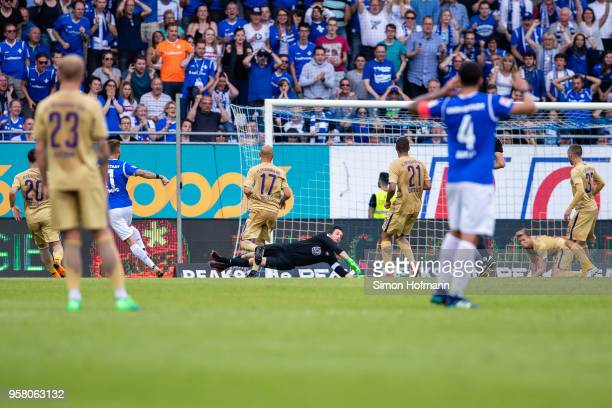 Tobias Kempe of Darmstadt scores his team's first goal past goalkeeper Martin Maennel of Aue during the Second Bundesliga match between SV Darmstadt...
