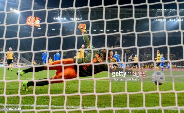 Tobias Kempe of Darmstadt scores his team's second goal past goalkeeper Kevin Broll of Dresden during the Second Bundesliga match between SG Dynamo...